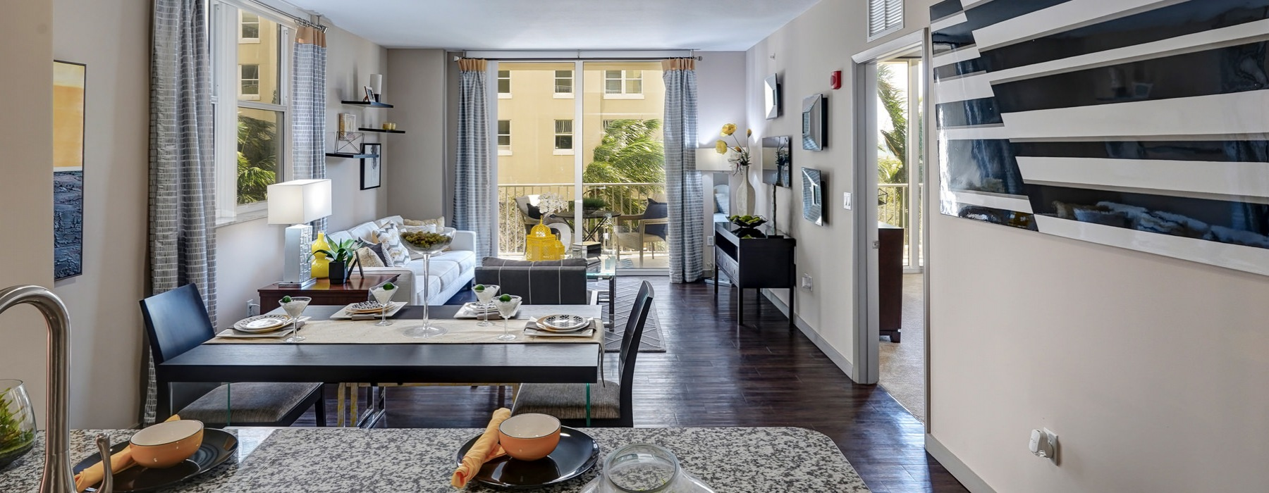 dining and living room areas with access to private balcony